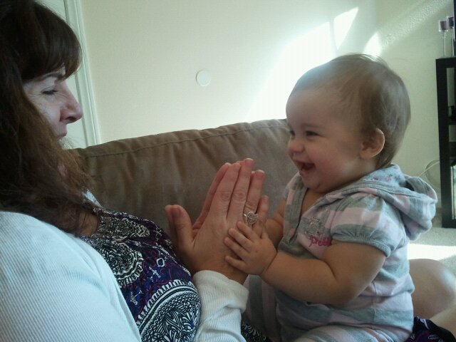 Nana and Ayda playing patty cake