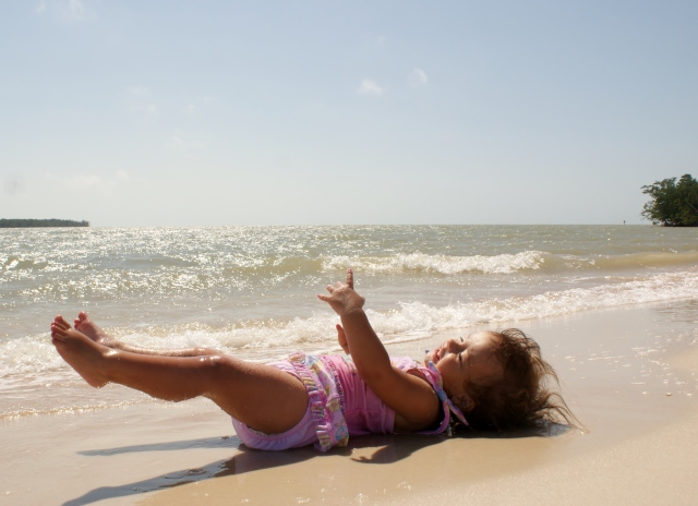 Ayda enjoying the sun, sand and surf